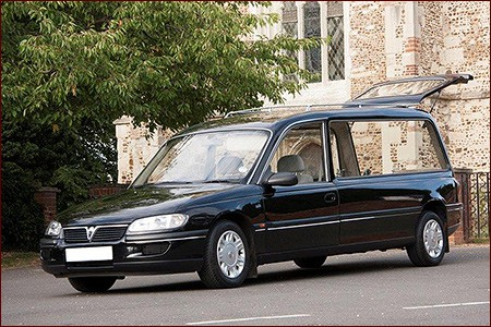 Traditional black hearse with tailgate open